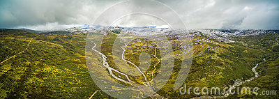 Aerial panorama of Snowy River and mountains in Australian Alps,