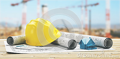 Yellow helmet with building projects and yard with crane