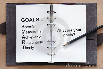 Tool of setting goal and what are your goals words on organizer book with pencil
