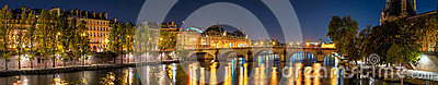 Panoramic view on the Seine River banks, the Pont Royal bridge, and Orsay Museum at dawn. Paris, 7th Arrondissement, France
