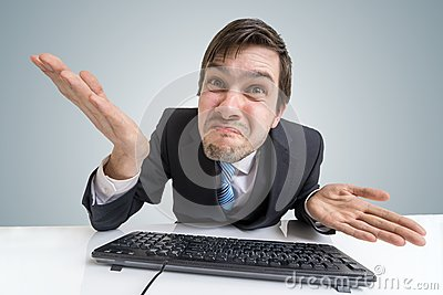 Confused frustrated and unsure man is working with computer