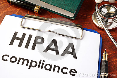 HIPAA compliance form on a clipboard.