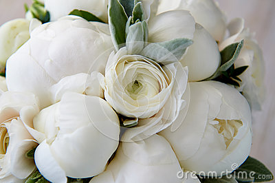 Wedding bouquet of white peonies and ranunculuses. Wedding floristry