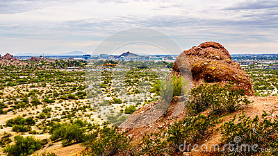 The city of Phoenix in the valley of the Sun seen from the Red Sandstone Buttes in Papago Park