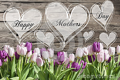 Happy mother`s day text heart with pink and white tulips rustic wooden background greeting card spring flowers