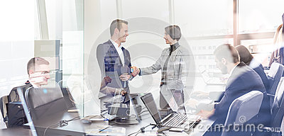 Business people shaking hands in moder corporate office.