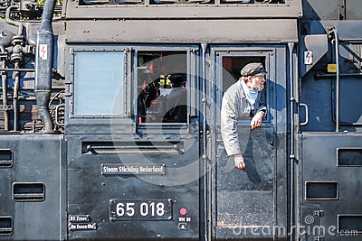 Bochum , Germany - April 18 2015 : Worker observing the activities at the railway main station