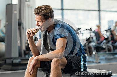 Man eating energy bar