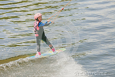 Extreme Park, Kiev, Ukraine, 07 may 2017 - a little girl to ride a Wakeboard. Photo of grain processing