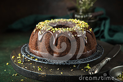 Chocolate  cake with chocolate glaze and pistachios