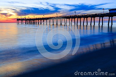 Venice pier, Florida, at sunset with intentionally blurry waves to show motions and beauty