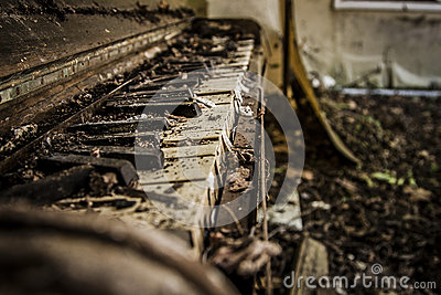 Tattered old abandoned piano