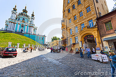 Tourists on Andriyivskyy Descent and Church