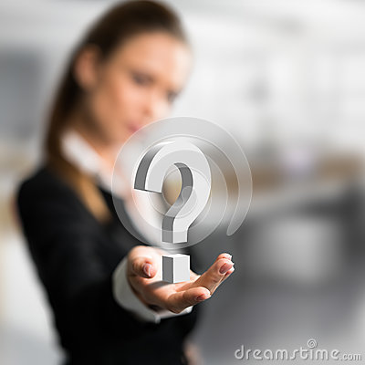 Businesswoman presenting a questionmark as symbol for a concern