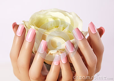 Manicured nails with pink nail polish. Manicure with nailpolish. Fashion art manicure, gel lacquer. Acrylic nails salon