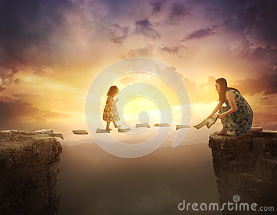 Child walking on pages over cliff