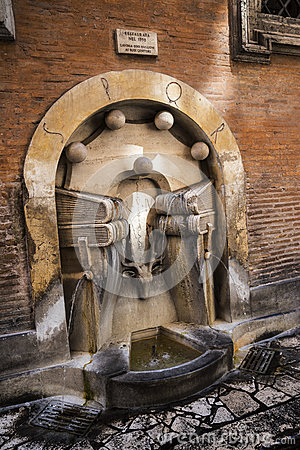 The Fountain of the National Archives in Rome Italy that has books as the main theme