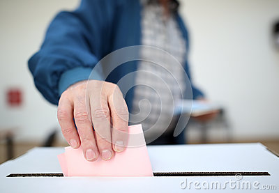 Man casts his ballot at elections