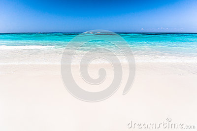 Beautiful tropical beach, white sand and blue sky background wit