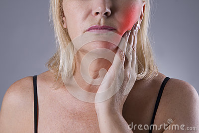 Aged woman with toothache, teeth pain closeup