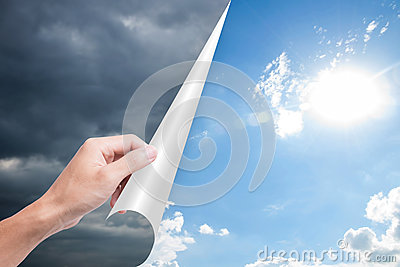 Hand opening page overcast to bright blue sky.
