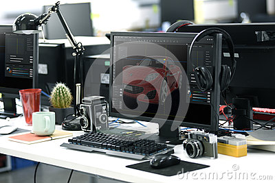 stock image of computer screen showing graphic car design on office table working