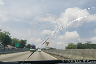 Perspective view of cracked car windscreen or windshield while d