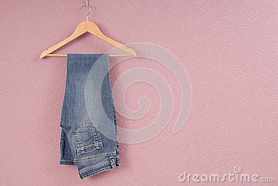 A blue jeans are on hanger.