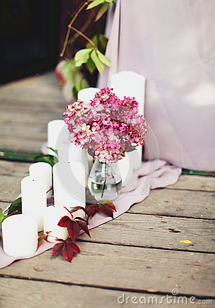 Candles and a vase with flowers