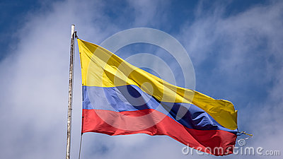 Waving Colombian Flag on a Blue Sky - Bogota, Colombia