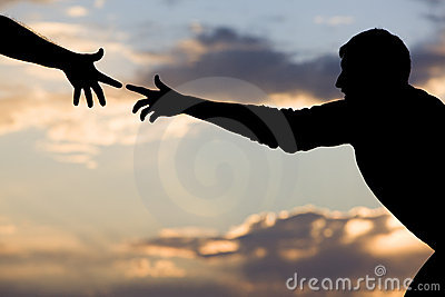 stock image of reaching for help