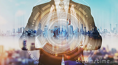 Businessman with city hologram and futuristic technology. futuristic creator business technology