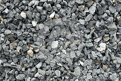 Aggregate of coarse gray stones, crushed at a stone pit, gravel pattern
