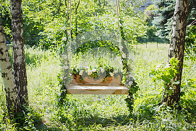 Swing overgrown with flowers
