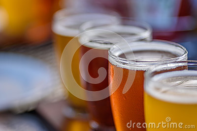 Closeup macro of a beer flight in sunlight