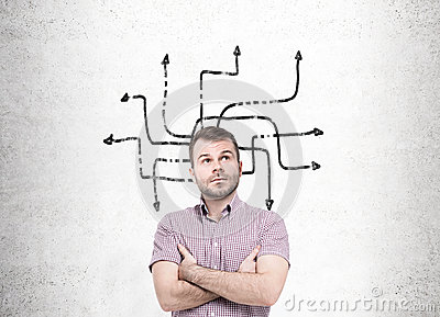 Man with crossed arms considering his options
