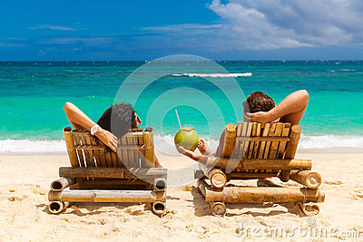 Beach summer couple on island vacation holiday relax in the sun