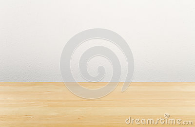 Brown wooden empty office desk with white wall
