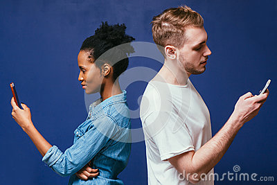 Technology separate people. Man, woman with phone