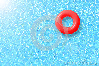 Red swimming pool ring float in blue water and sun bright.
