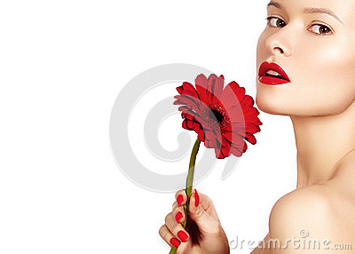 Close-up beauty photo woman with red lips, lipstick and beautiful red flower. Spa clean skin