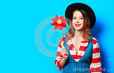 Smiling woman with red pinwheel