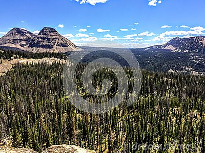 Panoramic Landscape View of Uinta Mountains, clouds, lakes and forest, Utah, USA, America West