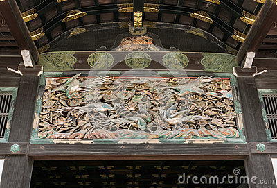 Carvings of exotic birds and floras beneath the entrance roof of Nijo Castle in Kyoto.