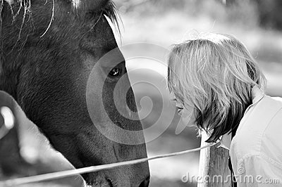 Black white soft loving tenderness woman and horse