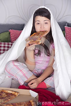 Night overeating pizza