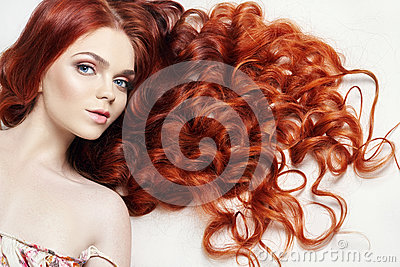 Sexy nude beautiful redhead girl with long hair. Perfect woman portrait on light background. Gorgeous hair and deep eyes. Natural