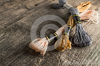 stock image of accessories for hobbies: different colors of thread for embroidery