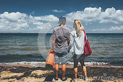 Couple Travelers Man And Woman Standing On Seashore Adventure Travel Relax Concept
