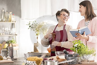 Woman reading grandmother recipes
